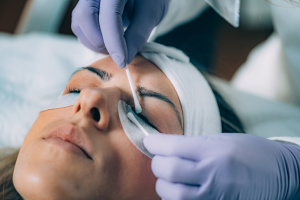 Cosmetologist Cleaning Woman's Eyes After Lash Lifting Procedure